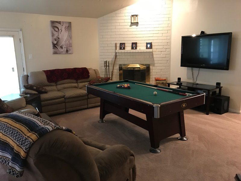 Living Room with TV and Pool Table