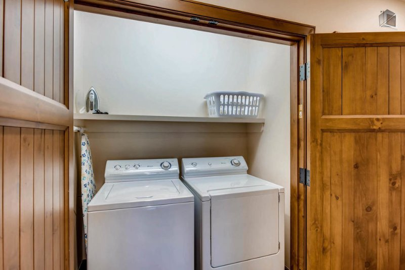 A separate laundry room makes it convenient to keep your ski gear fresh.