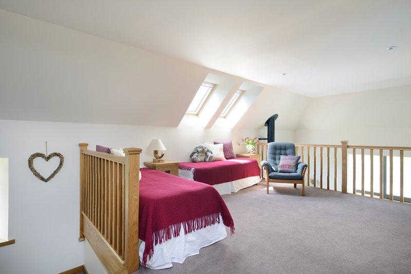 Mezzanine level with 2 single beds