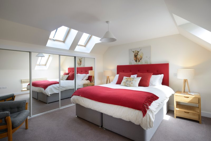 Upstairs bedroom with large double bed that can also be used as 2 single beds