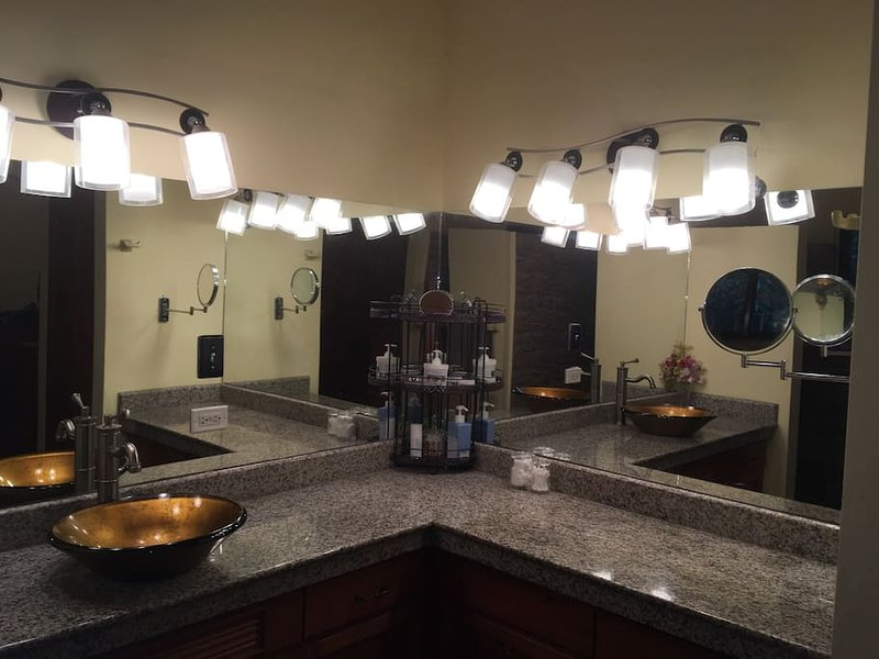 Beautiful lighting and granite counter tops in the Master bathroom. Lots of counter space/storage.
