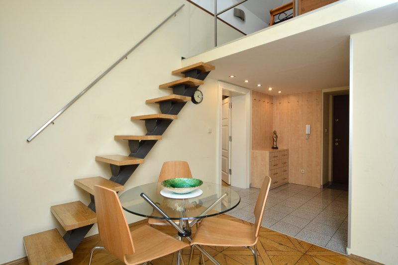 dining area and stairs to bedroom 1