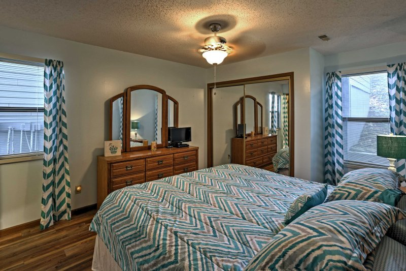 Make yourself at home in the master bedroom with king-sized bed, cable TV, and dresser.