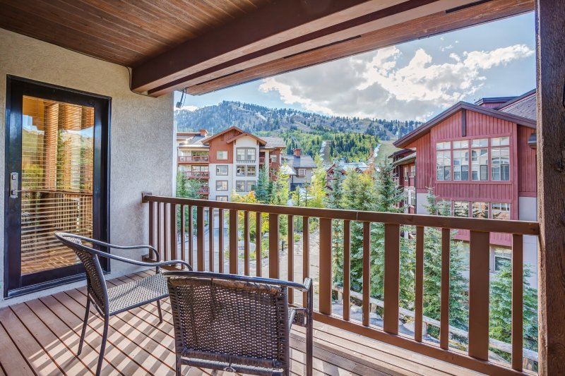 Enjoy fantastic mountain views from the balcony during your stay at this 4-bedroom, 4-bathroom vacation rental townhouse in Solitude!