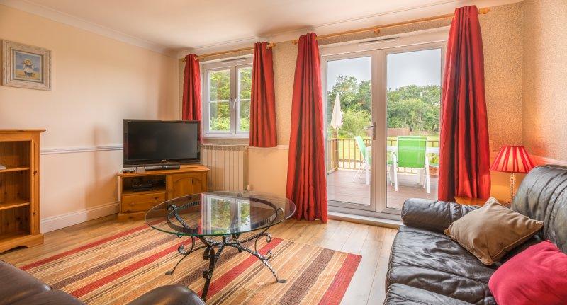 Ground floor cottage - living room with access to decide terrace overlooking back garden