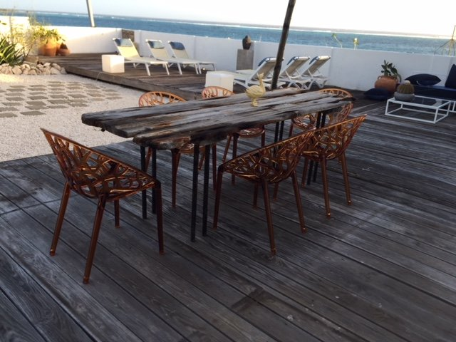 ample dining space next to water, listen to the ocean while eating