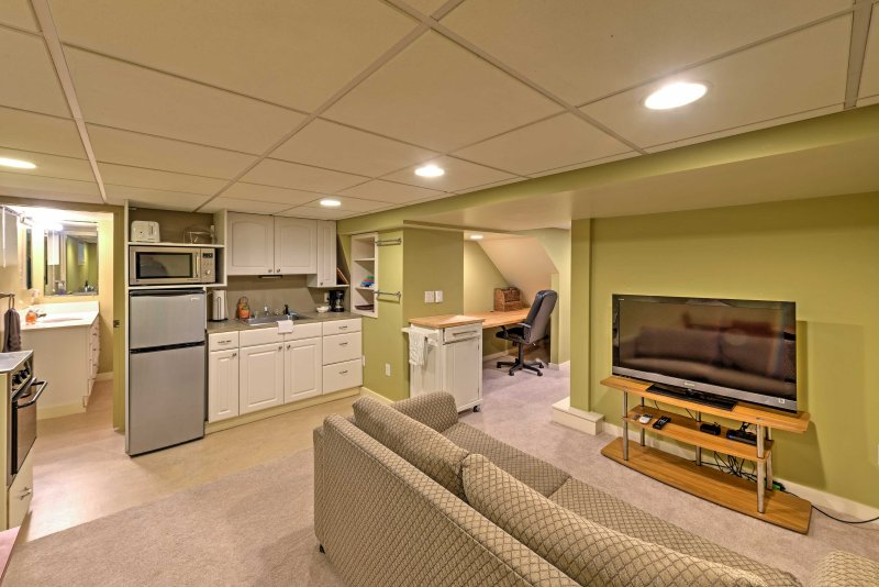The entire space is adorned with cozy furnishings and all of the necessary amenities for a comfortable stay.
