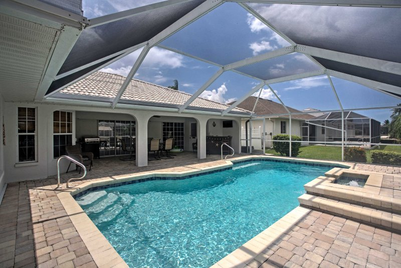Escape to Cape Coral in this 3-bedroom, 2.5-bathroom vacation rental home on the canal!