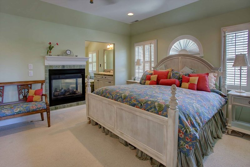 Master king bed with view of fireplace