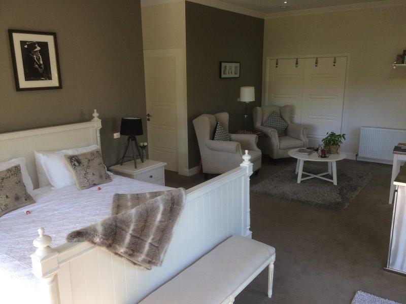 Guest room bedroom/ lounge area