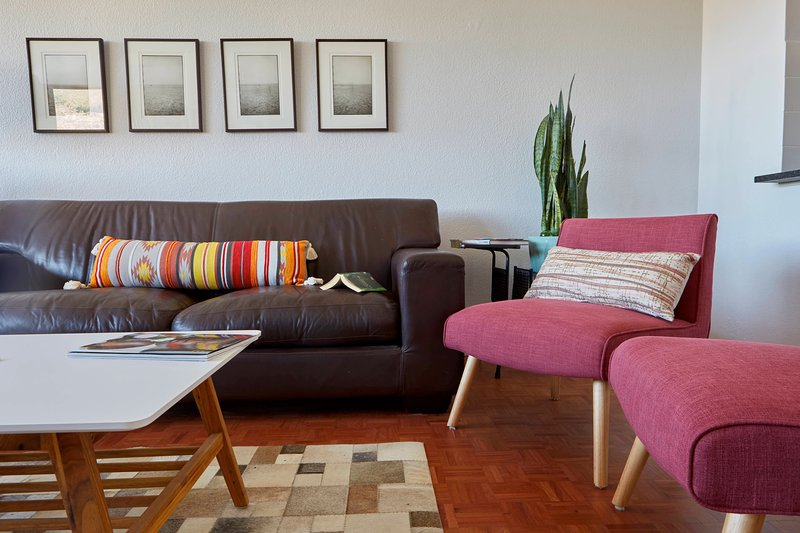Photographs of the beach in Rio de Janeiro, the comfiest couch in town, and gorgeous wooden floors