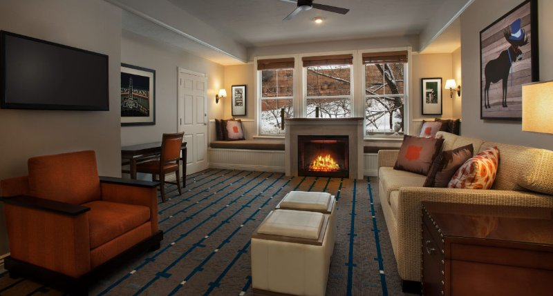 Spacious living room, with gas fire place, flat screen TV, and seating for all
