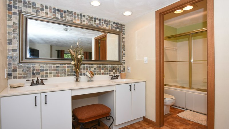Double vanity and shower/whirlpool tub in master suite