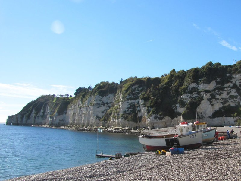 Fishing boats hauled up on Beer's shingle beach