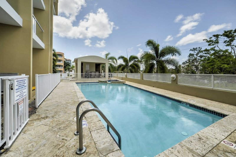Spend leisurely days lounging by the community pool, which features poolside internet access.
