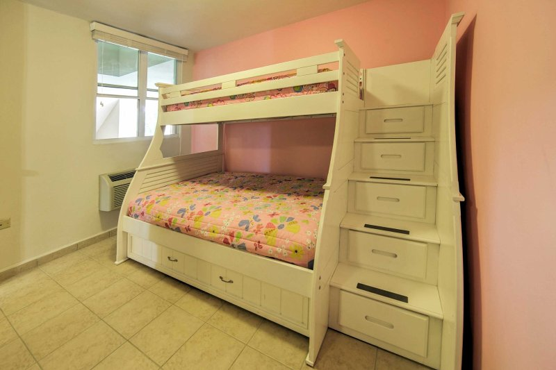 Rest easy on the twin-over-full bunk bed.