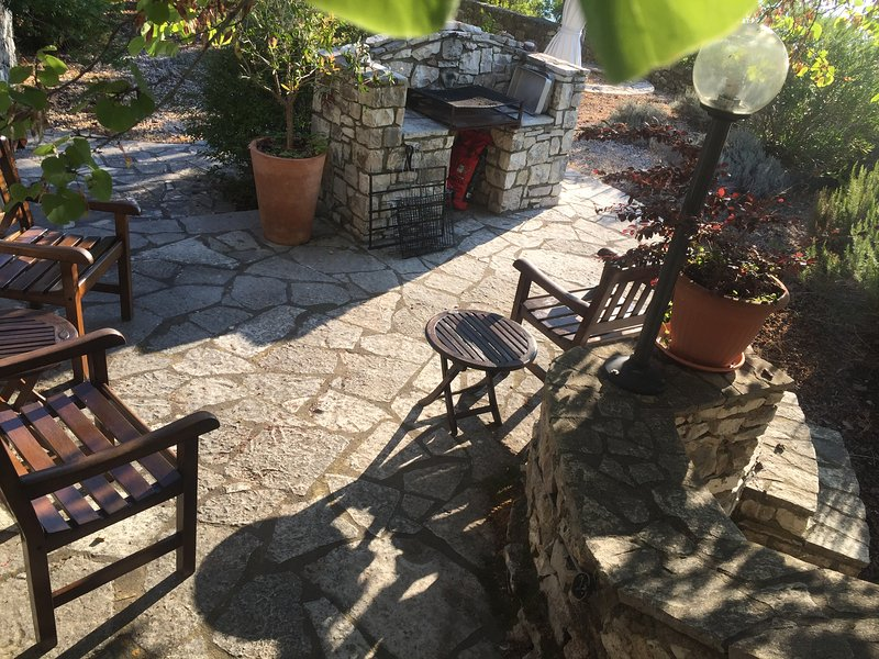 Spacious barbecue area with chairs, table, lighting. only  few steps away from the main terrace.