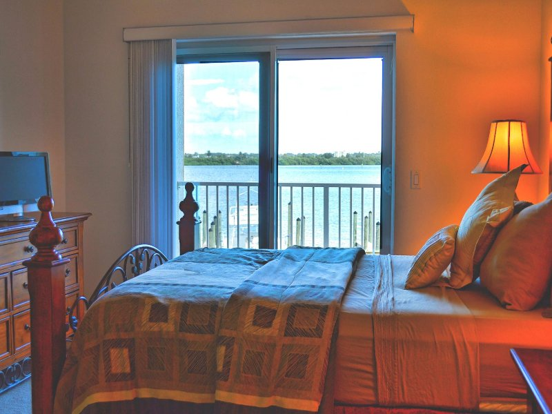 Guest bedroom has access to the balcony