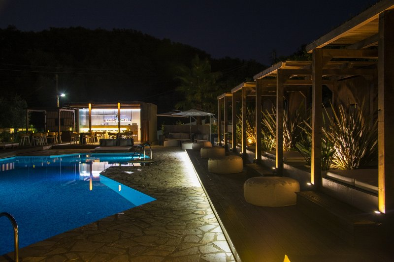 Pool bar and cabanas in the moonlight