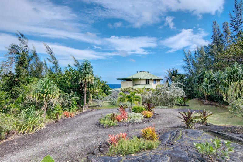 Enjoy the native landscaping and old pahoehoe lava outcropping in the front yard