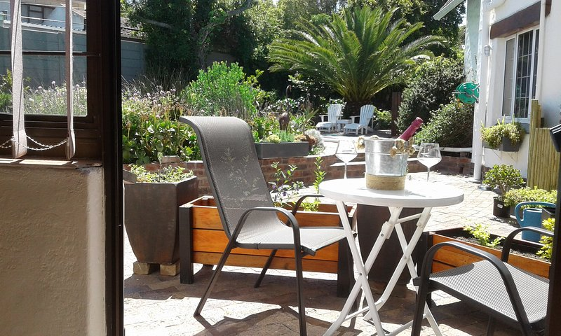 Lovely space to relax and enjoy the sun with view of garden and pool.