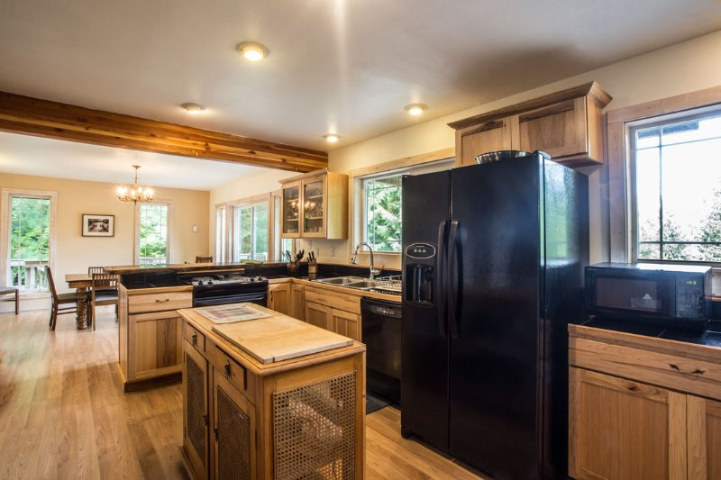 Kitchen area with all major appliances
