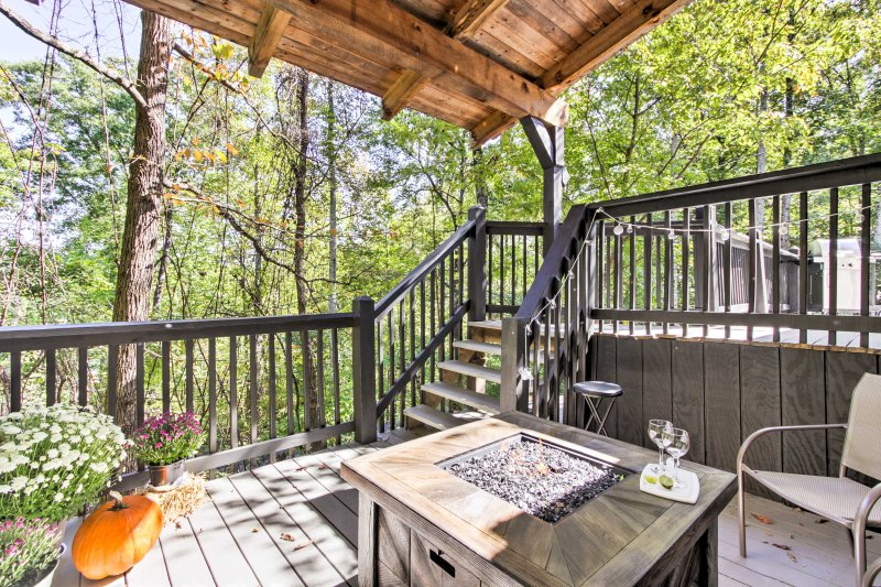 This home features a wraparound deck, perfect for lounging outside and taking in the peaceful surroundings.