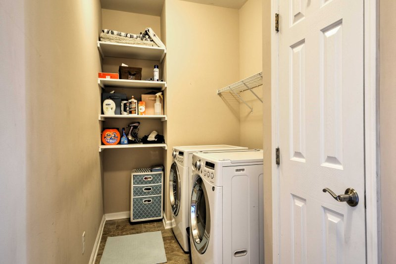 In-unit laundry machines are included for guest use.