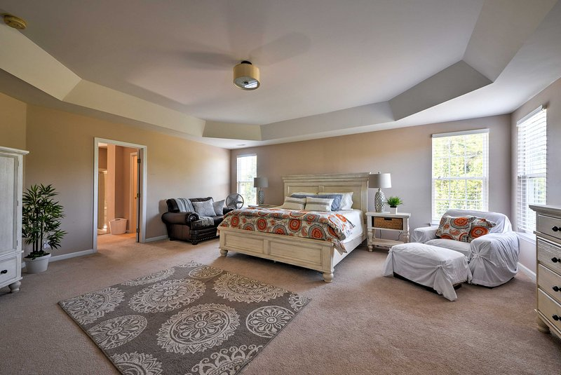 This spacious master bedroom boasts a king-sized bed.