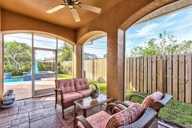 Screened In Lanai Area With Seating For 4; Pool View;