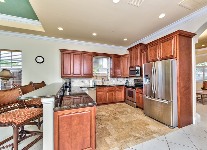 Fully Stocked Kitchen with all the Essentials; Countertop Has Seating For 3;