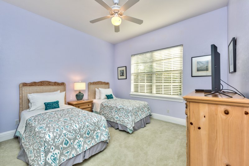 Twin Bedroom With Flat Screen TV and Fan;