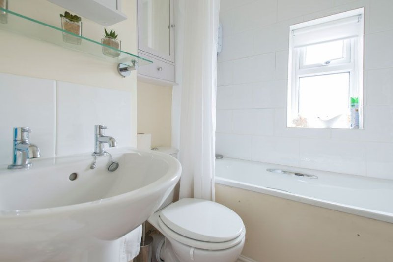Bathroom with shower over bath and WC
