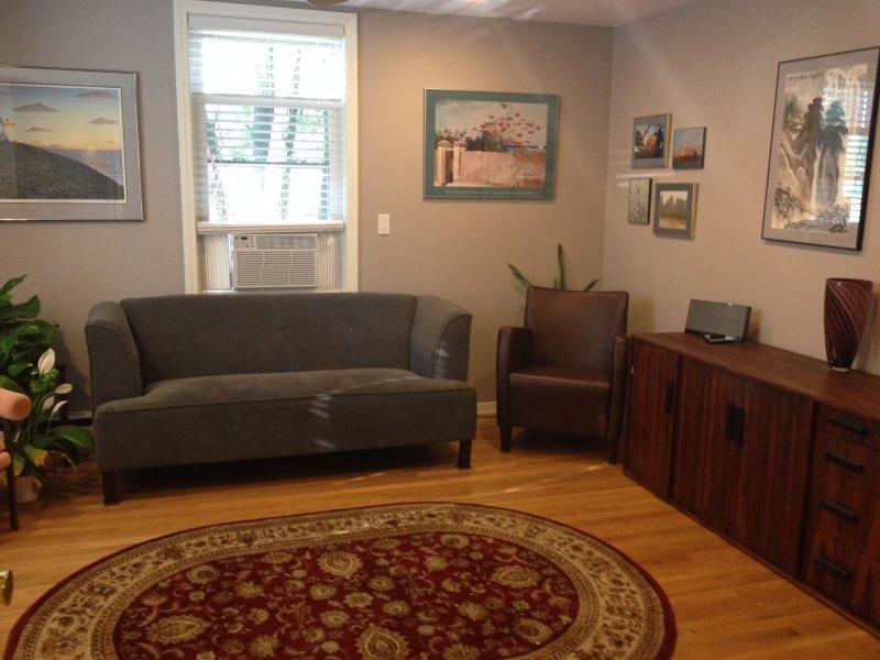 Livingroom with office desk set up.