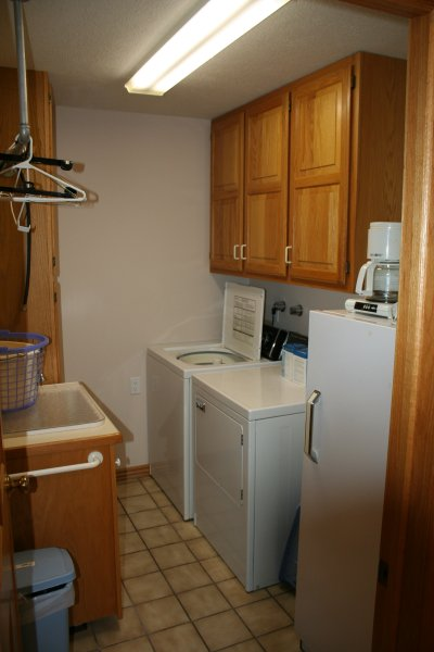 Full sized washer, dryer and deep freeze in room off of kitchen