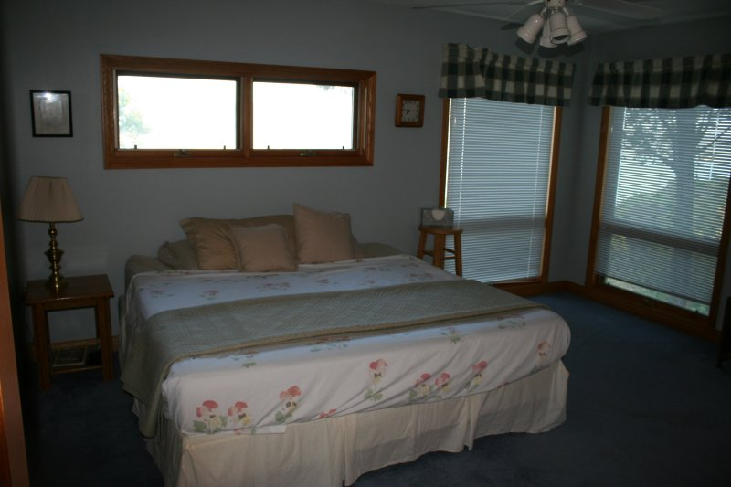 Master bedroom is upstairs with sleep number bed and ensuite shower bathroom