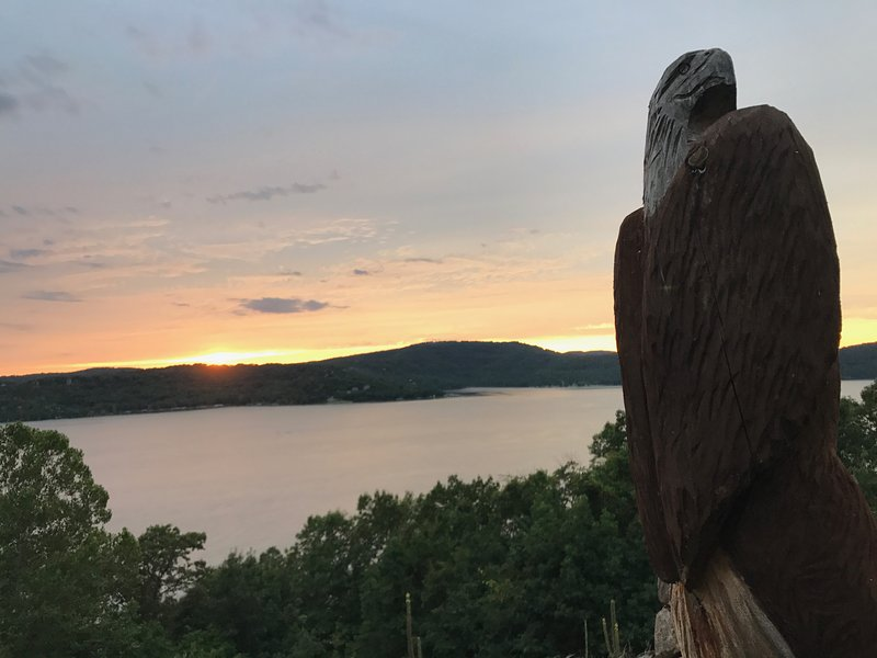 Beautiful sunset with our bald eagle carving in honor of our nation's bird who winters at the lake
