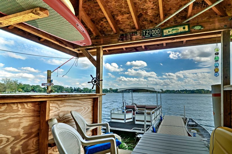 Spend lazy afternoons at the tiki bar or out on the private dock during your stay at this lakefront Waterford Township home!