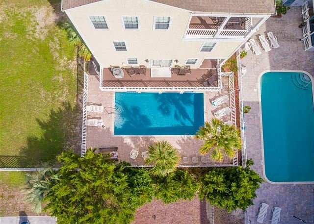 Backyard Oasis -- View of the Pool, Lounge Area and Sunset Balco