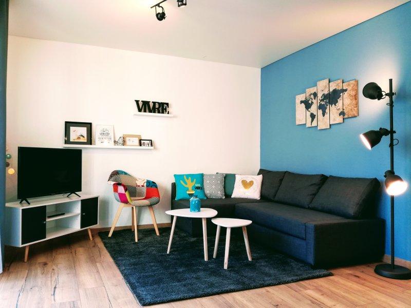 Nice área de estar com sofá-cama 140x200