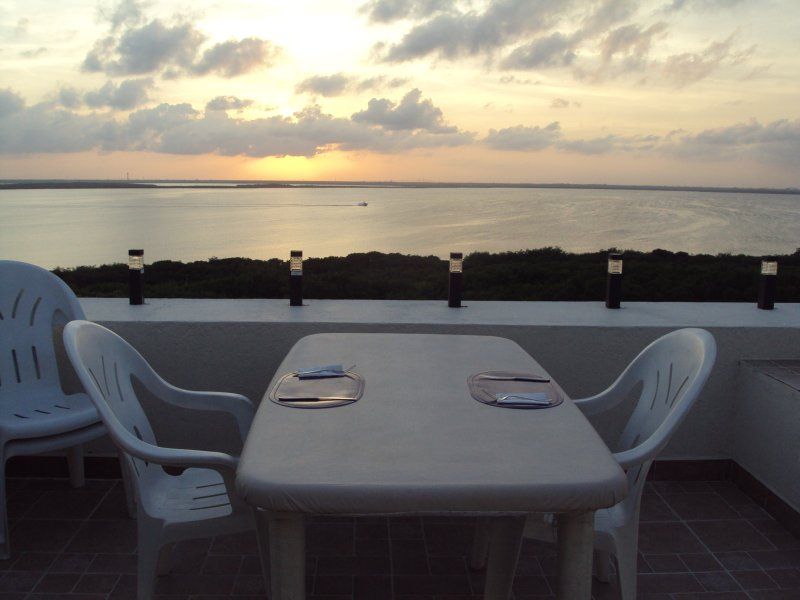 Dining at sunset on your private terrace.