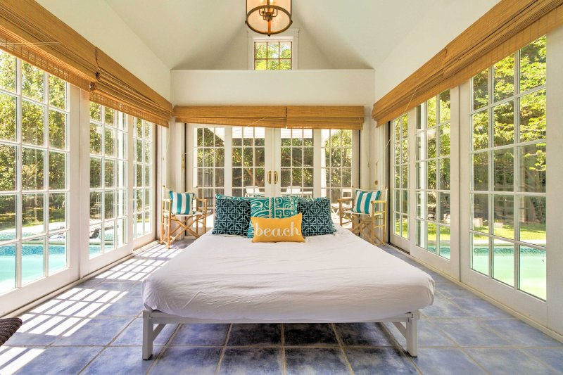 A Royal Dutch daybed sits beneath a vaulted cathedral ceiling in the sun room.
