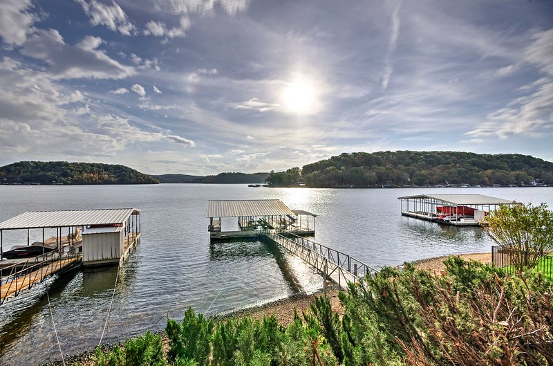 This Lake of the Ozarks home offers a private dock and boat slip.