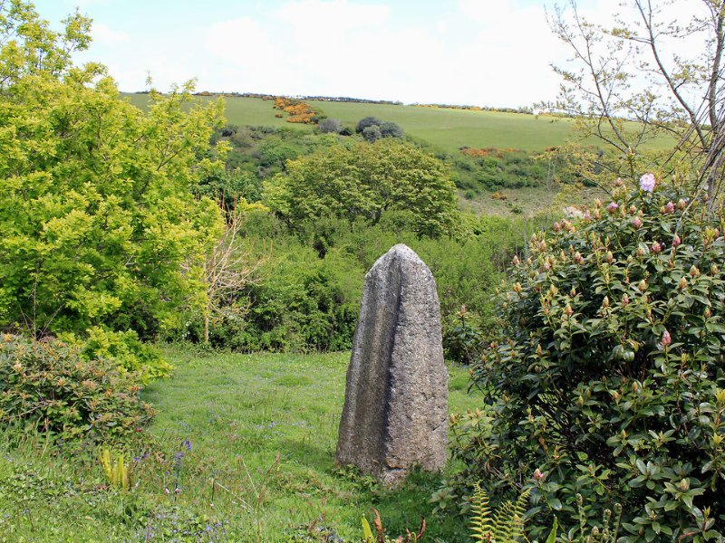 A standing stone adds to the timeless quality of the surrounding landscape