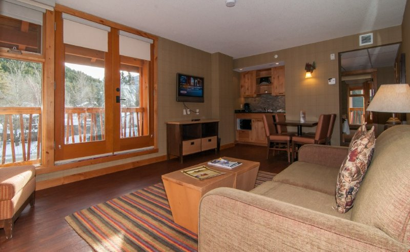 Enjoy a glass of wine on your spacious, private balcony while appreciating the alpenglow on the mountains.