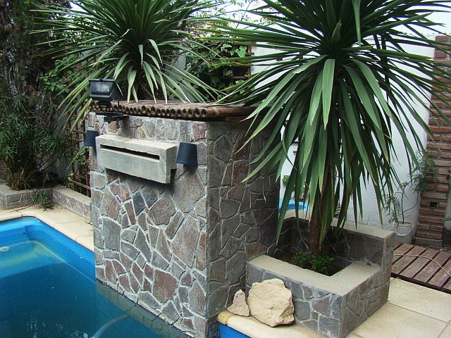 our waterfall / pool-deck solarium complex