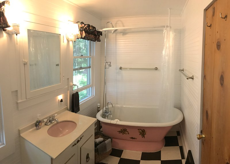 2nd floor bathroom.  Claw foot tub with a hand shower sprayer and shower spout