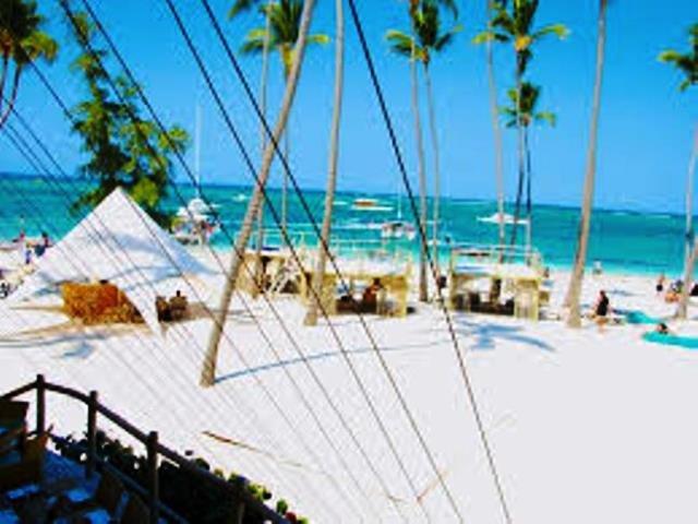 Take the FREE shuttle service to the Jellyfish Beach Club on white sands Bavaro Beach