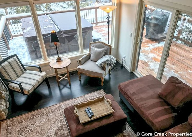 The Modern Living Room Has Access to the Large Deck with Hot Tub and Grill