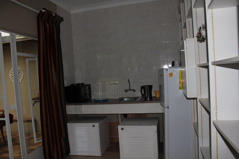 open plan kitchen mini stove fridge microwave toaster kettle cooking utenstils